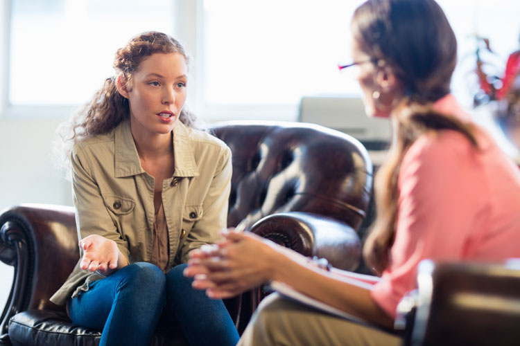 woman talking to her therapist in individual therapy - waypoint recovery center - substance use disorder treatment services - south carolina addiction treatment center - alcohol and drug rehab in SC