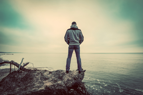 Life in Alcohol Addiction Recovery - man standing by lake - waypoint recovery center