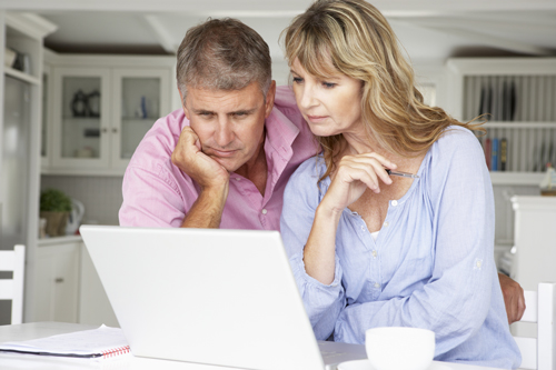 How to Bring an Addiction Professional into Your Intervention - couple searching the internet