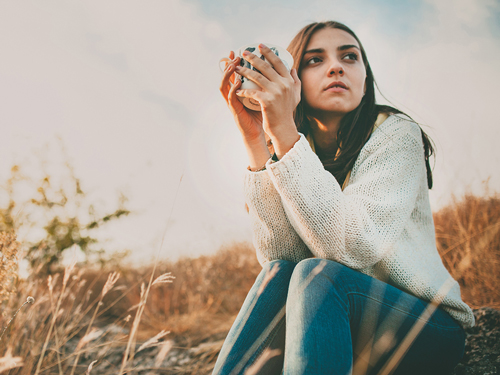 Understanding and Avoiding 9 Common Relapse Triggers - woman thinking
