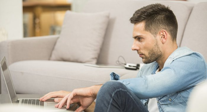 7 Ways to Help You Get Your Career Back on Track: Job Hunting Tips for People in Recovery - young man in living room on laptop