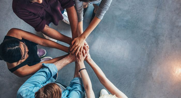 6-Alternatives-to-12-Step-Groups-Finding-the-Support-You-Need-to-Stay-Sober - five people with hands on top of each other in circle