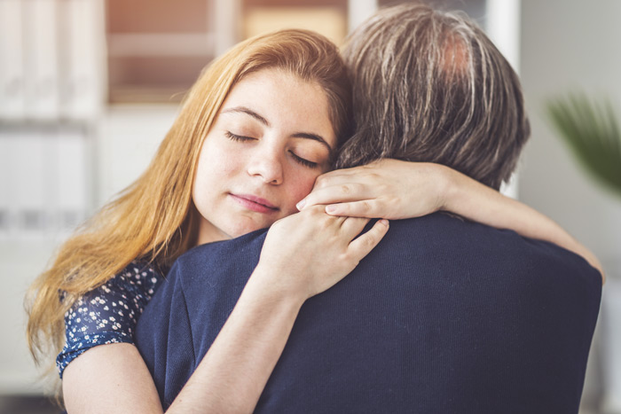 woman embracing her father