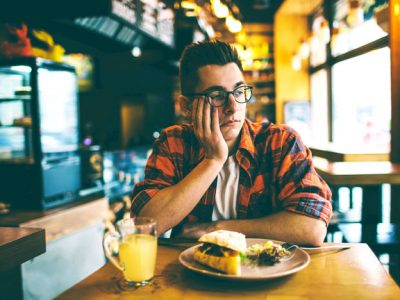 man in restaurant with no appetite