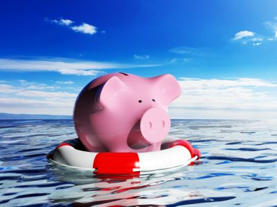 piggy bank on lifesaver in water - addiction treatment