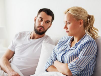 young couple looking upset - spouse's addiction