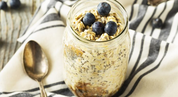 overnight oats in mason jar topped with fresh blueberries - stress