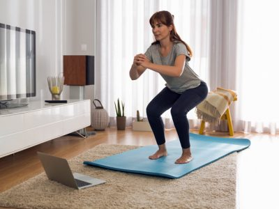 middle age woman doing exercises at home - uncertainty