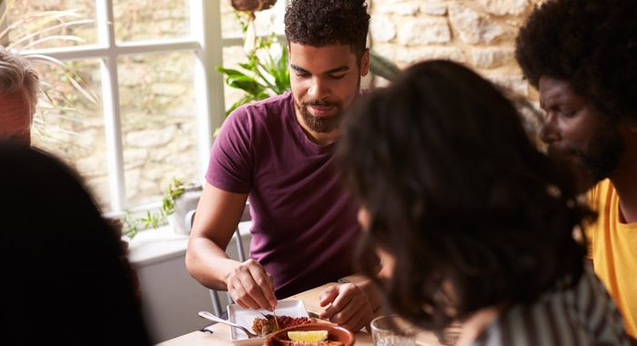 diverse friends or family sharing a meal - building relationships