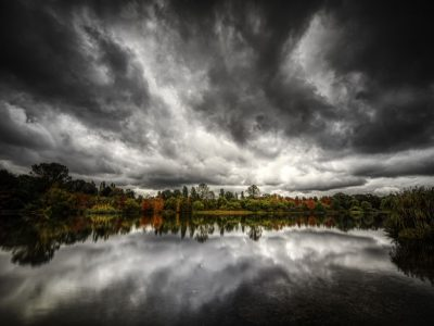 dark and stormy sky reflected over lake - seasonal affective disorder